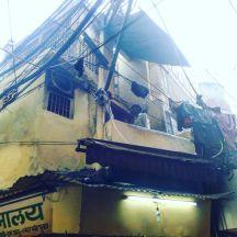 A building in a narrow alley in Old Delhi market